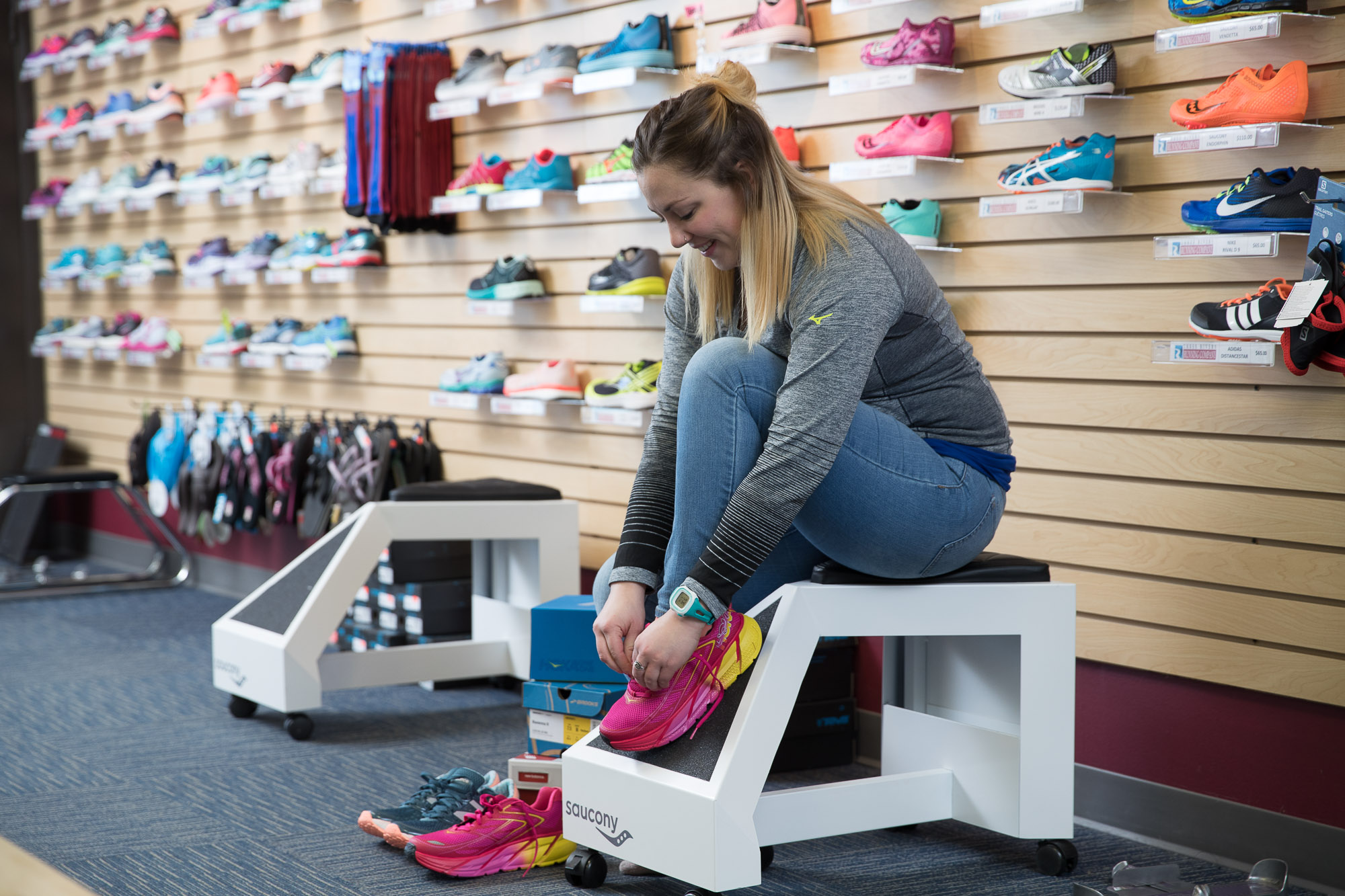 A young girl tries on a pair of running tennis shoes from the 3Rivers Running Company in Fort Wayne.