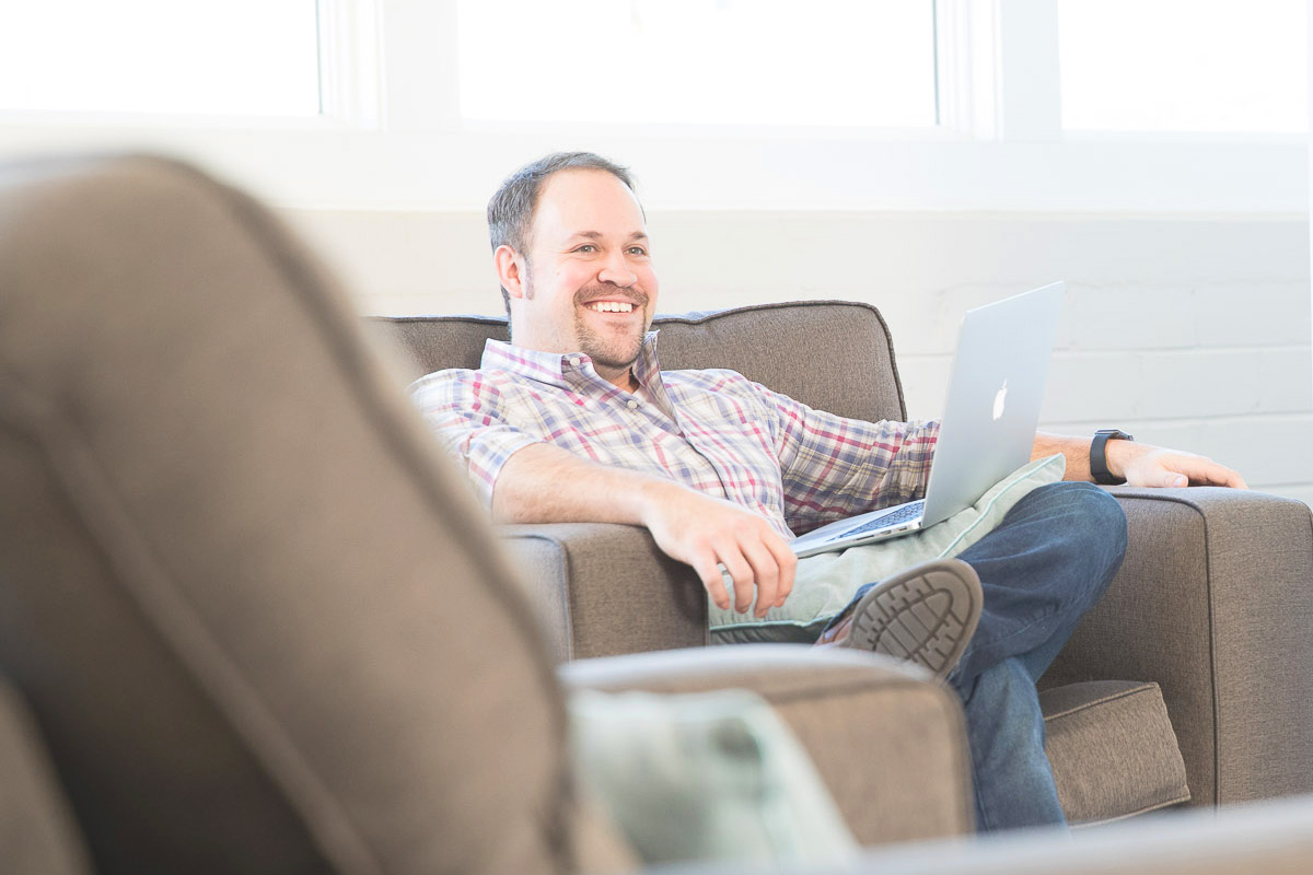 Nate Reusser of web agency, Reusser Design, works with his team on a new website.